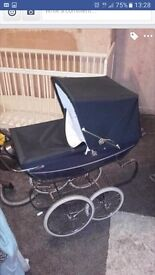 Blue silver cross dolls pram, used a handful of times bought bran new last xmas..