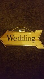 Wooden wedding arrow sign