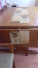 SOLID TEAK EXTENDING DINING TABLE FREE TO GOOD HOME