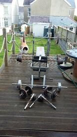 cast iron weights, bars and free bench
