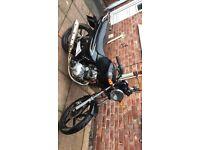 sym 125 road bike read add