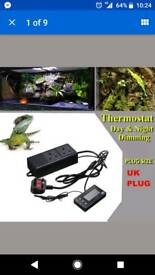 Reptile mat and day and night thermistat