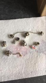 Genuine silver with gold pandora charms and safety chain