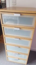 Tall set of 5 drawers with glass front, in good condition, small mark on top