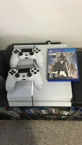 PlayStation 4 with two controls  destiny game. And camera