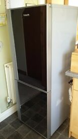 Baumatic grey fridge freezer with mirrored front good working order. Needs new freezer seal