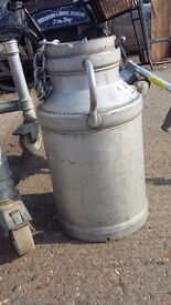 3 old milk churns all different styles