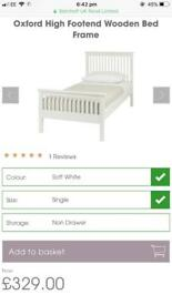 Single bed, white wooden bed frame.