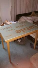 Fold out table with glass top, small cut on one edge