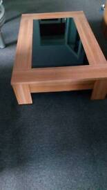 Wooden coffee table with black glass
