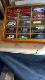 X15 diecast model cars in display case nice collection