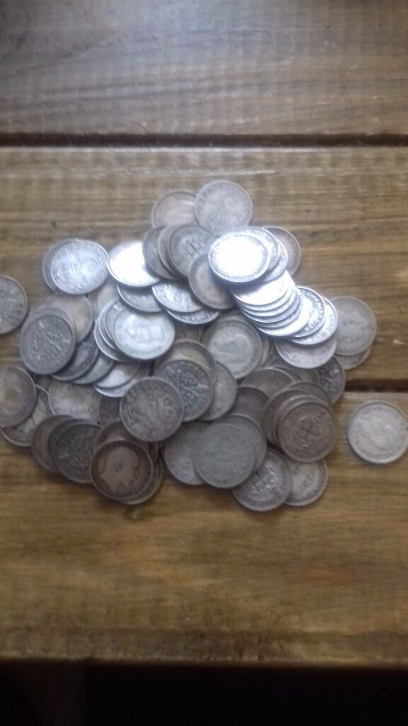 Small pile of 3 pence coins