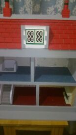childs wooden dolls houses in good condition with some furniture