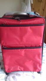 NEW LIGHTWEIGHT SUITCASE BY IT RED