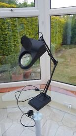 Angle poise lamp with powerful magnifying glass