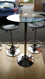 Glass Pedestal Table with two Stools
