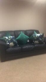 Leather 3 piece suite . Navy Italian leather excellent condition no marks or scratches.