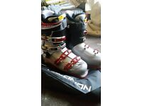 Men's Salomon ski boots used twice size 8.5-9 (26.5). Silver with red buckles excellent condition