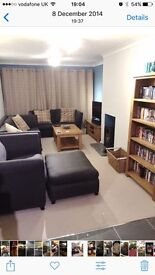 Large grey fabric sofa suite VGC 4 years old. Inc footstall with pull out single sofa