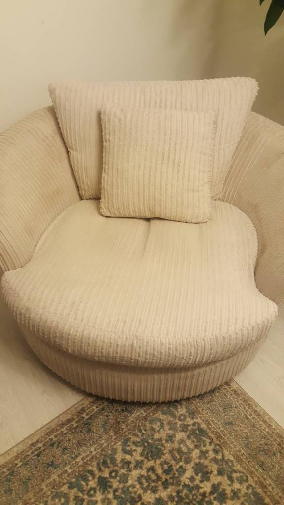 Cream swivel chair for sale perfect condition