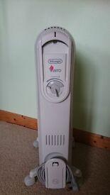 Delonghi 1500 Watt Vento oil filled electric heater for sale.