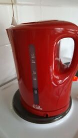 red plastic cordless kettle