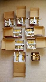 9 pairs of Victorian scroll lever door handles on back plate - polished brass