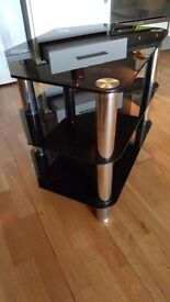 Black glass tv stand...chrome legs