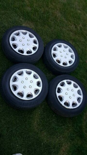peugeot 206 steel wheels with hub caps wheel caps good tyres | in
