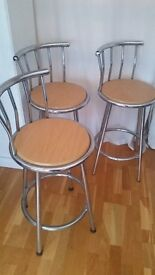 3 Metal bar stools with wooden seats