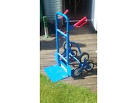 Stairclimbing trolley - enables easy manoeuvring of bulky goods up stairs