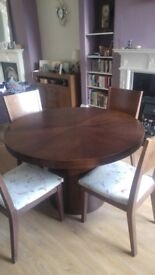 Round dining table and 4 chairs.