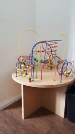 Beaded wooden activity table