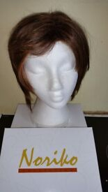 Beautifully styled top designer wig. Best UK supplier. Boxed in excellent condition