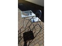 Glass and silver grey metal desk and folding chair. Can deliver. Vgc.