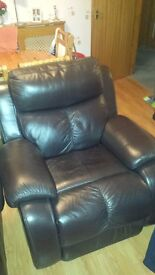 2x brown leather armchairs