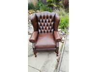 BROWN LEATHER CHESTERFIELD QUEEN ANNE CHAIR.