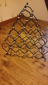 Wine rack holds 19 wine bottles..freestanding heavy wire..