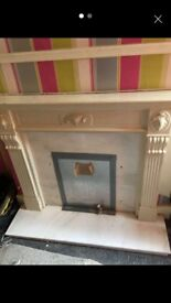 Cream marble fireplace surround and base