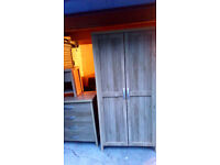 STUNNING BEDROOM SET COMPRISING WARDROBE DRAWS AND BEDSIDE CABINET TWO WEEKS OLD LIKE NEW SIZE BELOW