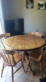 Solid pine round kitchen table & 4xchairs diameter 105cm, height 77cm pet/smoke free home.
