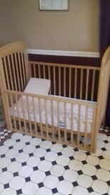 wooden baby cot rolling sides.