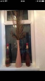 Large vase with twigs and two glass bottle for decorations