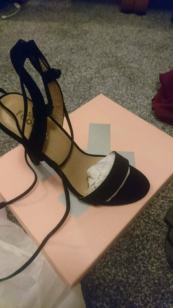 Brand new, in box, black lace up heels size 5