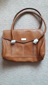 A gorgeous brand new Fiorelli handbag, tan in colour with beautiful blue internal trimmings.