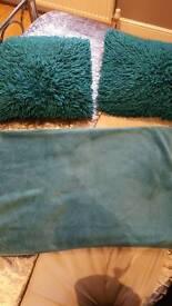 Teal throw and shaggy fur cushions