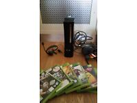 Xbox 360 120 GB comes with headphones and 6 games