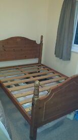 Heavy solid wood double bed.
