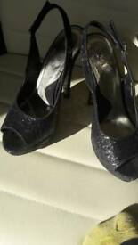 Woman's sparkly high heel shoes size 6