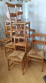 Set of 8 Vintage Chapel Chairs with Rush Seats and Bible Boxes.